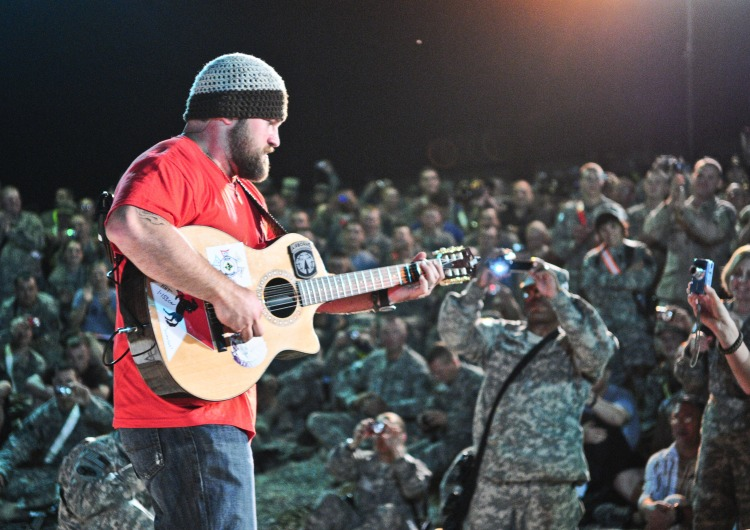 Country music singer Zac Brown gets up close and personal with troops during a USO show in Mosul, Iraq, on April 16, 2010. (USO Photo by Erick Anderson)