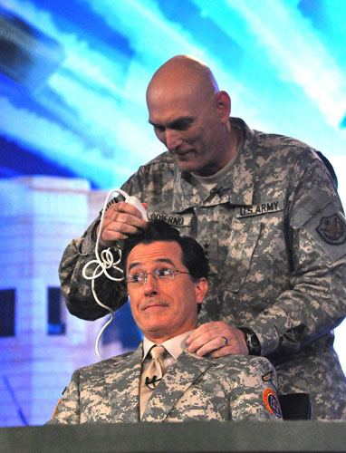 Gen. Ray Odierno gives Stephen Colbert a haircut during Colbert's performance for U.S. military personnel June 7, 2009, in Baghdad. USO Photo by Steve Manuel