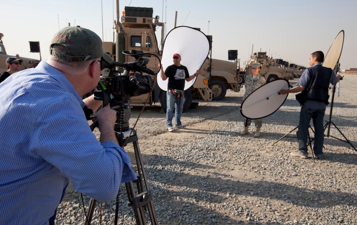 A VH1 crew video crew interviews SrA Jennifer Jensen