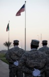 Soldiers approach the flagpole for the retreat ceremony