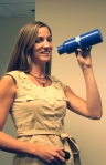 USO intern Caroline quenches her thirst with a Team USO water bottle