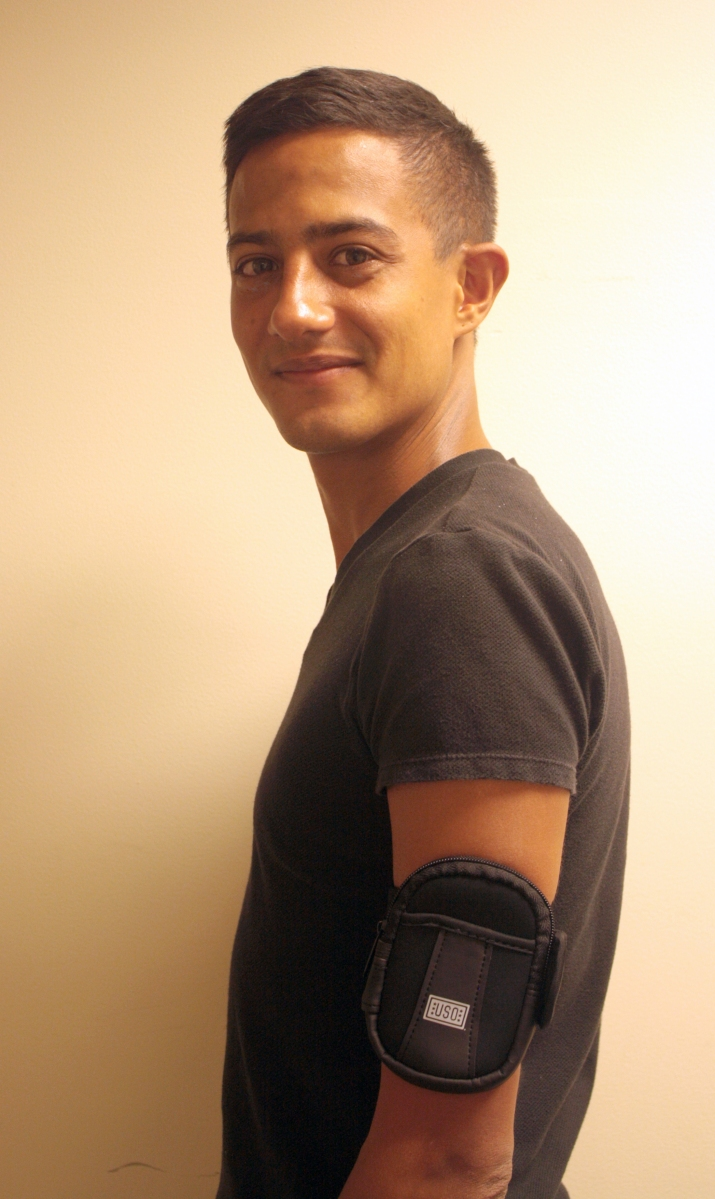 Navy veteran and USO employee Oscar sports a USO MP3 player armband