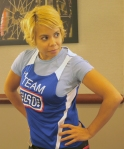 USO employee Vyque models the exclusive Team USO singlet