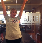 USO employee Sam jumps for joy over her Team USO tee!