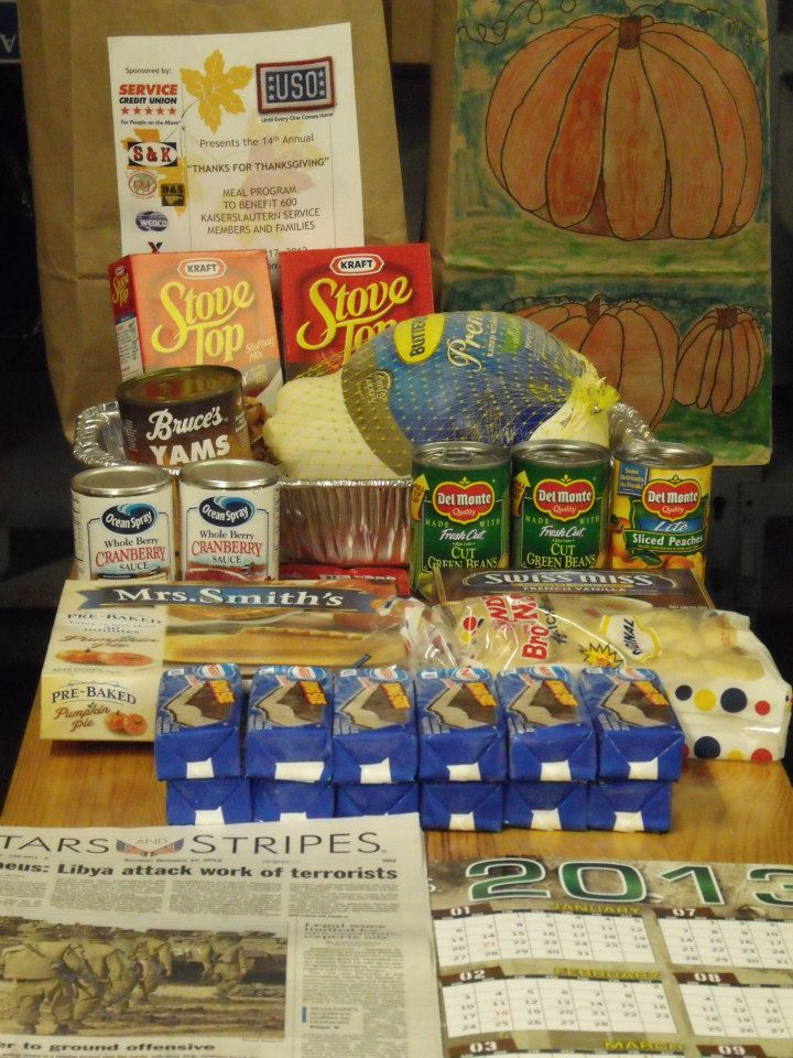 Junior enlisted troops were individually selected based on their family size and financial needs to receive a full Thanksgiving dinner, complete with stuffing, cranberry sauce, and even a movie to watch with the family. USO photo