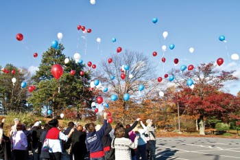 A USO/TAPS camp in Boston earlier this year ended with a balloon release. The balloons are released in remembrance of loved ones who died. USO photo by Michael A. Clifton