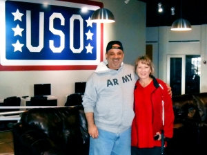 Jay and Kerri Giglio pose inside USO Fort Campbell, Ky., after driving from Texas to deliver 18 boxes of donated goods. USO Fort Campbell photo