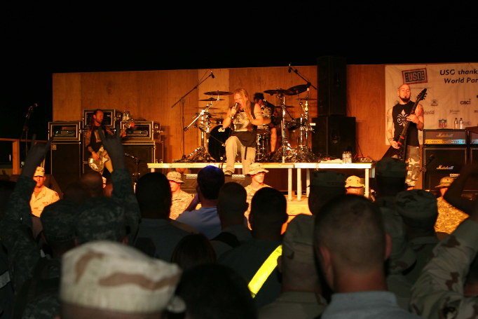 The band rocks out for the troops during their 2006 tour to Kuwait, Iraq and Germany