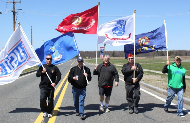 From left, Brian Willette, Dick Burgess, Jim Bouchard, Steve Jimmo and Kevin Willette walk during the USO of Pioneer Valley's USO Pat Tillman Center 5K Shadow Run on April 21 on Westover Air Reserve Base, Mass. Photo courtesy of Brian Willette