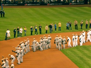 Fifty-eight troops participated in a mass first pitch May 27 at Miller Park in Milwaukee. USO photo