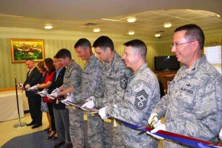 Troops and USO staffers prepare to cut the ribbon to officially open the new USO Osan on Osan Air Base, South Korea. USO photo