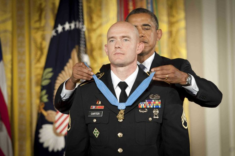 Army Staff Sgt. Ty Michael Carter receives the Medal of Honor from President Barack Obama on Monday at the White House. Photo courtesy of the Army