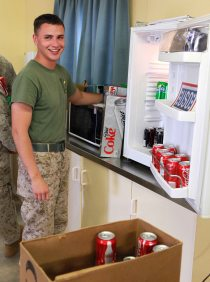A Marine with Lima Company, 3rd Battalion, 3rd Marine Regiment, Marine Rotational Force - Darwin, stocks the USO day room fridge on Wednesday. Photo by Marine Sgt. Sarah Fiocco