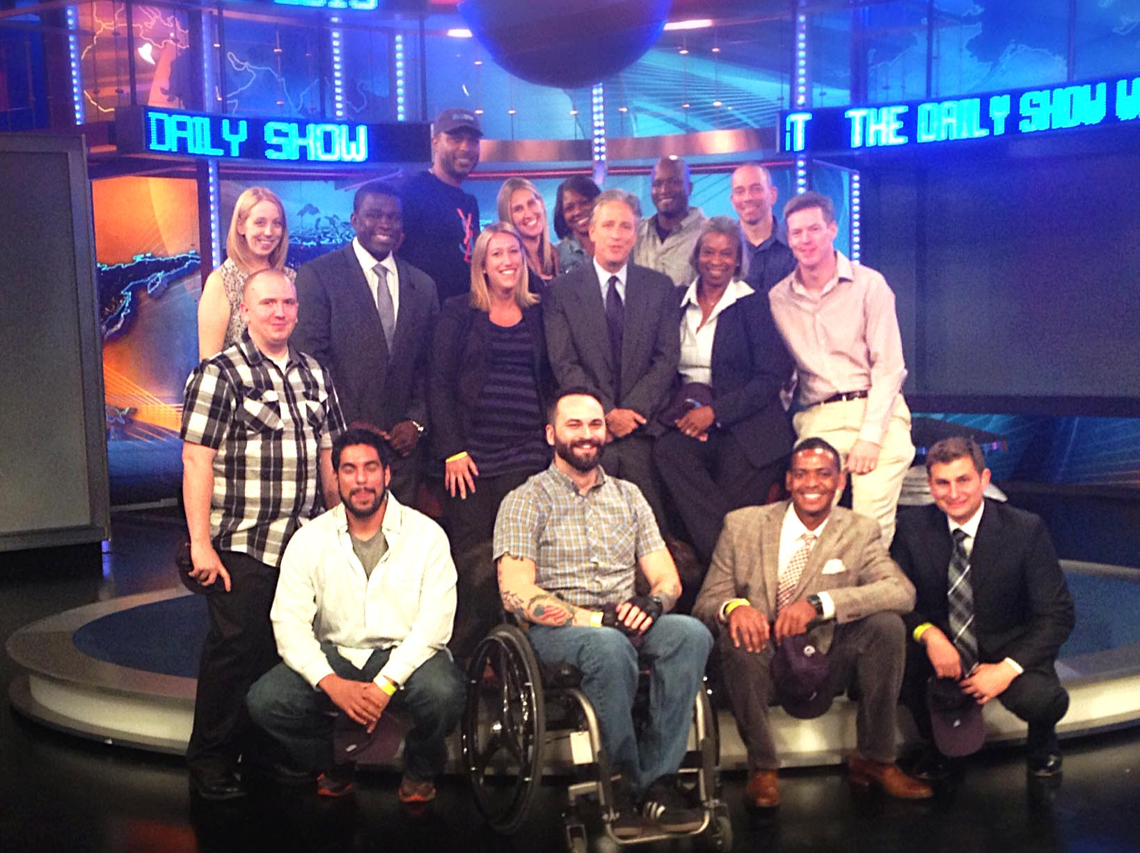 "A group of wounded, ill and injured troops and their guests meet with ""The Daily Show"" host Jon Stewart, center, in New York City on Thursday. Stewart hosted the USO outing. USO photo"