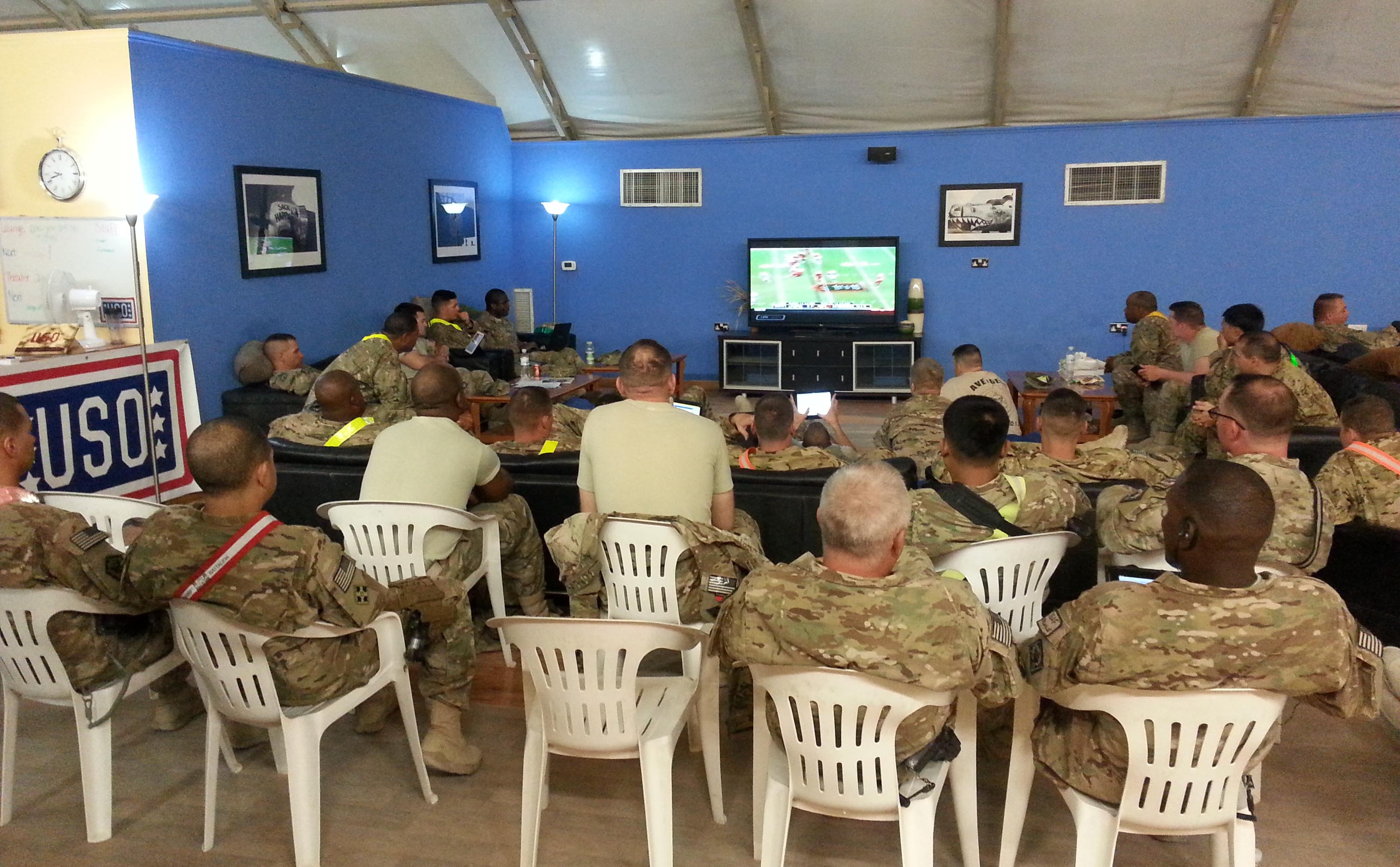 Troops gather at USO Kandahar in Afghanistan to watch football, courtesy of NFL Game Pass. USO photos by Daniel Wood