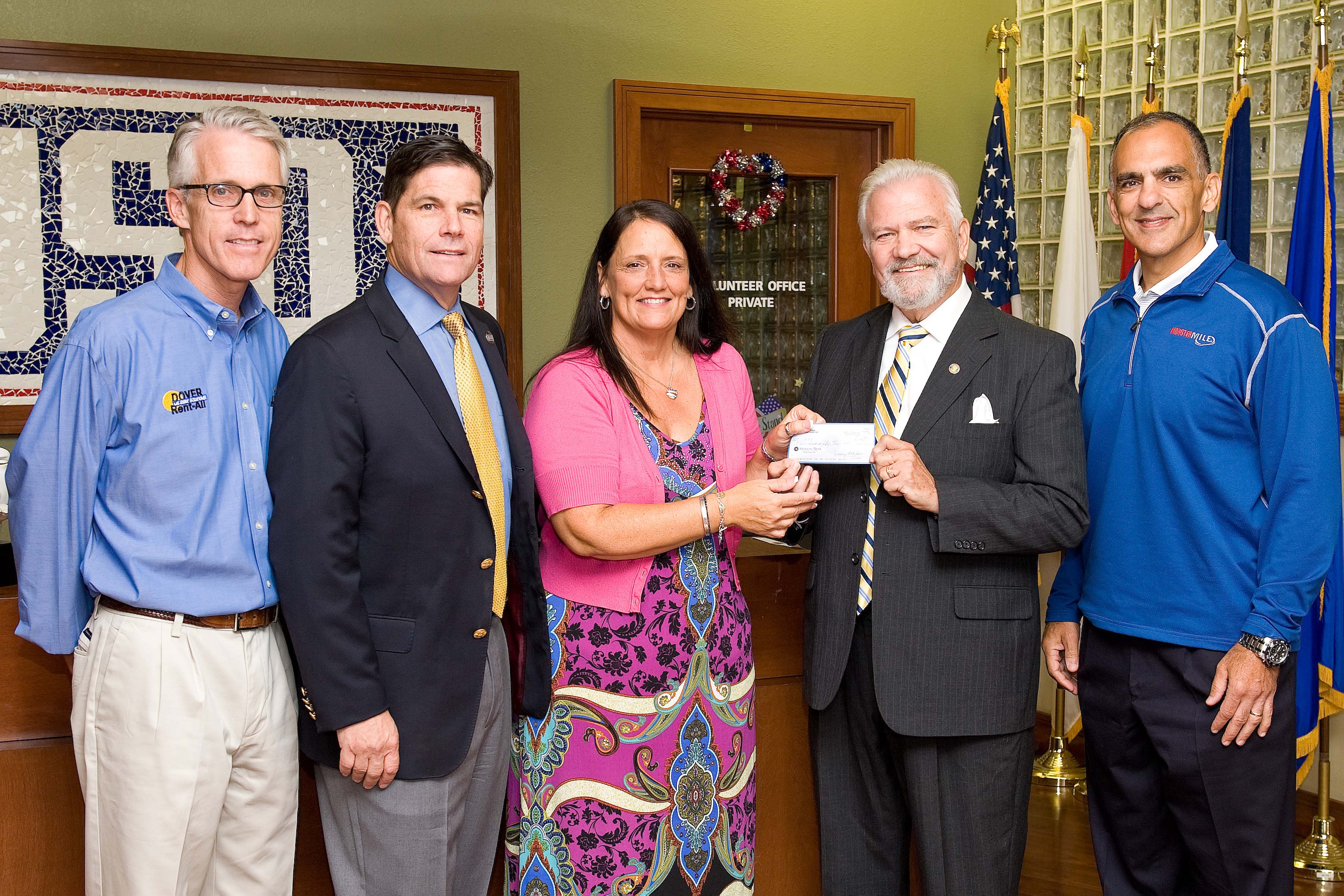 Dave Skocik, second from right, quartermaster of Veterans of Foreign Wars Memorial Post 9962, presents a check to USO Delaware Director Joan Cote on Sept. 19. Also pictured are outgoing USO Delaware board members Dave Clapp, left, and C. Scott Kidner, second left, and USO Delaware Chairman Mike Tatoian, far right. Air Force photo by Roland Balik