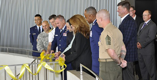 Members of the military along with Chicago Department of Aviation Commissioner Rosemarie Andolino, Vice President American Airlines - Chicago Franco Tedeschi and USO of Illinois President and CEO Alison Ruble prepare to cut the ribbon Oct. 2 opening the new USO center in Terminal 3 of Chicago O'Hare International Airport. USO photo