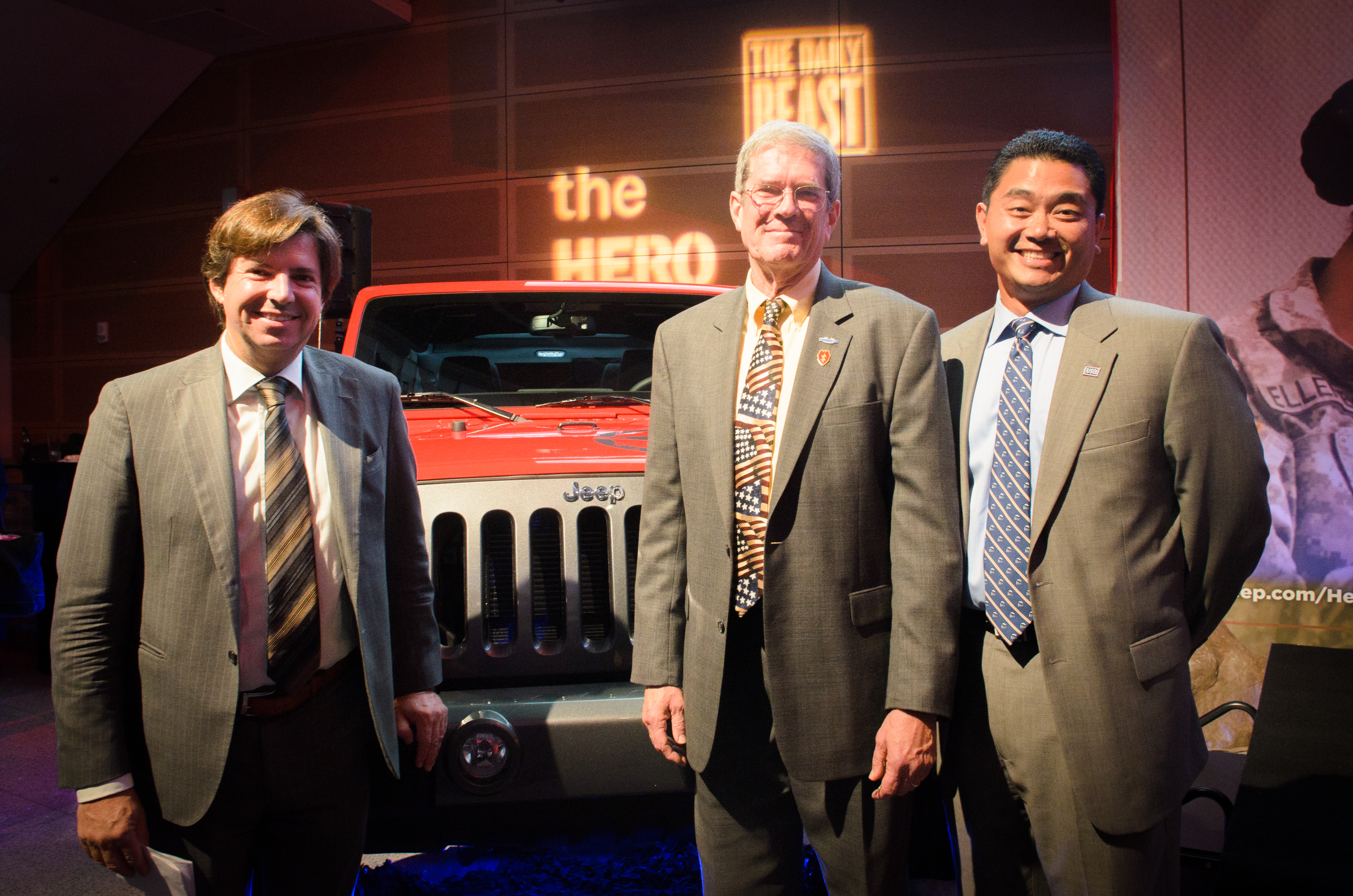 Norm Hallowell, center, poses with the USO's Senior Vice President of Operations Alan Reyes, right, and Chrysler Chief Marketing Officer Olivier Francois, after winning a new Jeep Wrangler on Oct. 11 in Washington. (Photo courtesy of Jeep)