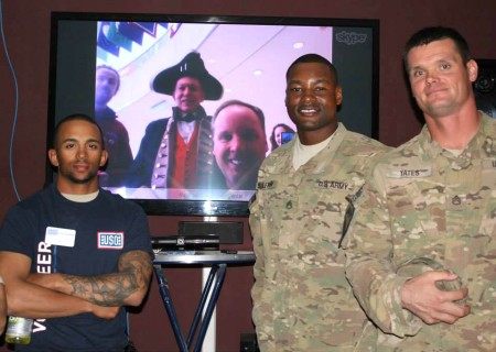 Troops at USO Kandahar pose next to a Skype connection to the National Constitution Center in Philadelphia during a Veterans Day event. USO photo