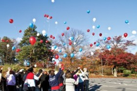 A USO/TAPS camp in Boston in 2012 ended with a balloon release. The balloons are released in remembrance of loved ones who died. USO photo by Michael A. Clifton