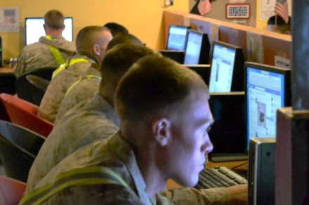 Troops use Facebook at a USO center in 2012. USO photo