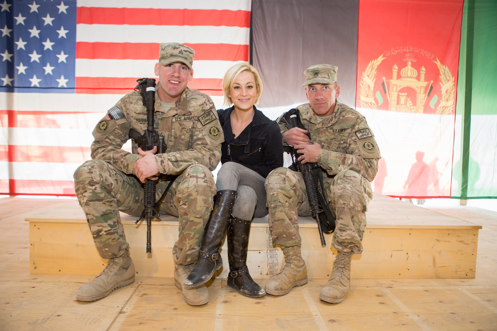 Country music singer Kellie Pickler poses alongside Sgt. Jeremy Harrington, left, and Sgt. Robert Epley, who built the stage the trio is sitting on for Pickler's performance at Forward Operating Base Walton, Afghanistan. USO photo by Eric Raum