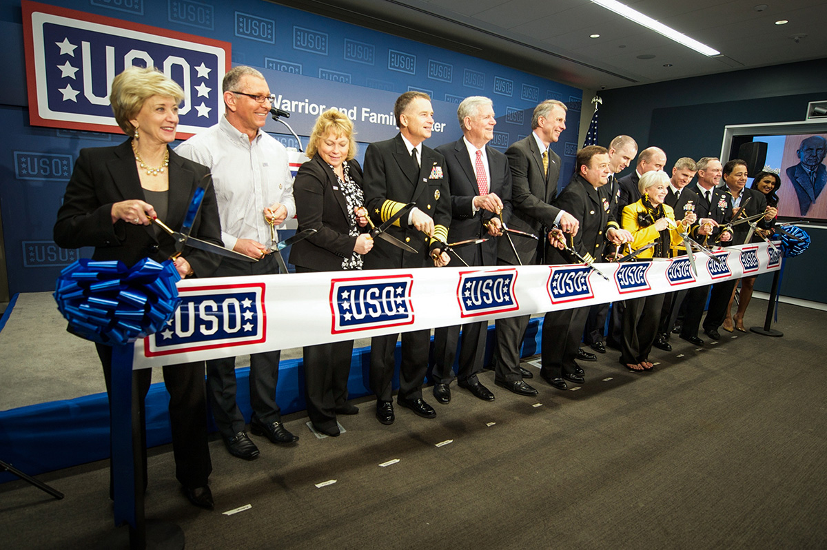 USO officials, military leaders and celebrities cut the ribbon to USO's Warrior and Family Center at Bethesda.  USO Photo by Mike Theiler