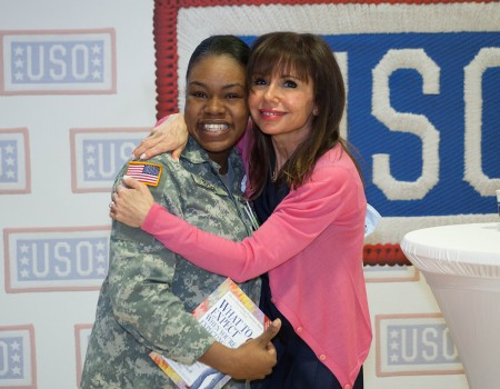 Best-selling author Heidi Murkoff hugs a service member at a Special Delivery baby shower held in Landstuhl, Germany, in March. USO photo