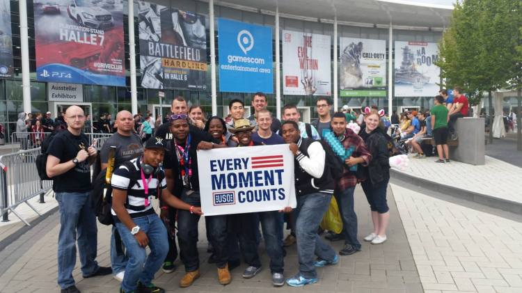 Troops smile outside of the gamescom convention. USO photo.