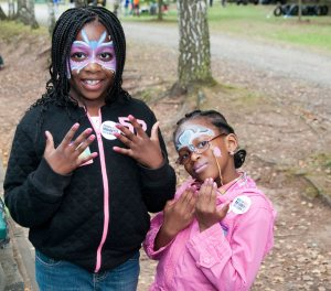 Girls show off their nails and face paintings at Sun and Fun day with Kaiserslautern USO. USO photo.