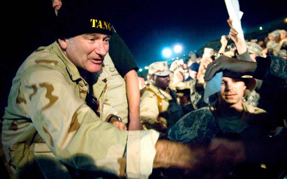 Comedian Robin Williams greets troops during a 2007 USO Chairman's Holiday Tour stop at Camp Arifjan, Kuwait, on Dec. 17, 2007. Photo by Chad J. McNeeley/Courtesy of the Department of Defense