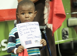The son of a deployed service member sends a message to his dad at the Mobile USO at the BET Experience at the Los Angeles Convention Center in late June. USO photo by Eric Brandner
