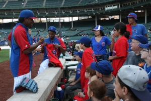 Cubs pitchers Edwin Jackson and Wesley Wright signed autographs and posed for photos with the USO group. Photo courtesy of the Chicago Cubs