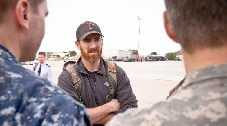 The Nationals first baseman Adam LaRoche chats with troops in Souda Bay, Greece, during the 2013 USO Chairman's Holiday Tour on Dec. 7. USO photo by Mike Clifton