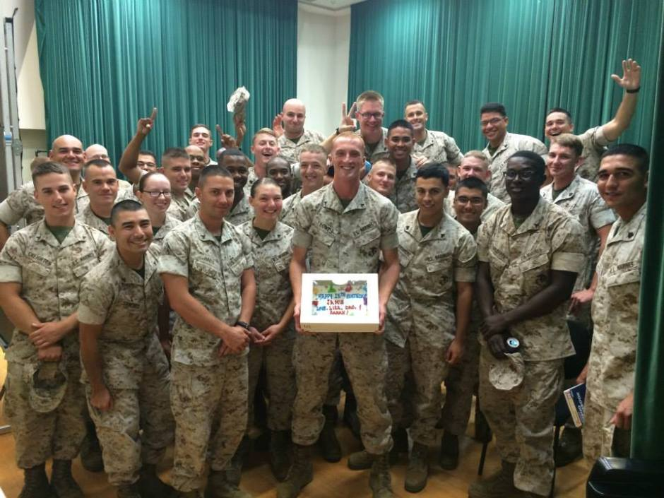 Marines smile with a birthday cake at a USO Center on Okinawa, Japan. USO photo