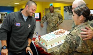 Nick Swisher receives a birthday cake during a USO tour stop at Kandahar Airfield, Afghanistan, on Nov. 25, 2011. USO photo