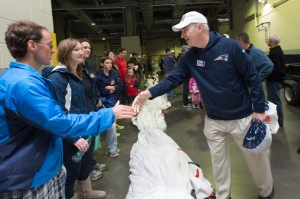 USO President and CEO Dr. J.D. Crouch II shakes volunteers' hands. USO photo by Gretchen Ertl