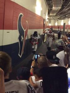 TACT participants from USO Houston watch the Texans run through the tunnel onto the field. USO photo