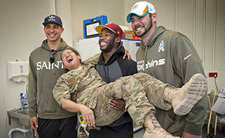 Pierre Garçon goofs around with a service member on his March 2014 USO Tour. USO photo by Dave Gatley