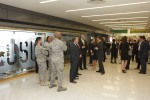 Troops and guests mingle outside the new USO center, which was donated by JetBlue.