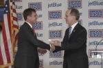 USO of Metropolitan New York CEO Brian Whiting, left, shakes hands with JetBlue CEO Dave Barger -- who is also a USO of Metropolitan New York board member -- at Wednesday's ceremony. JetBlue donated the new center.