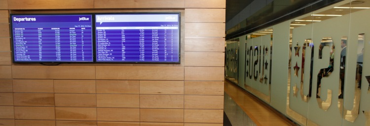 Arrivals and departures boards inside the USO at JFK International Airport in New York, so troops and families don't have to guess about their flights. USO photos