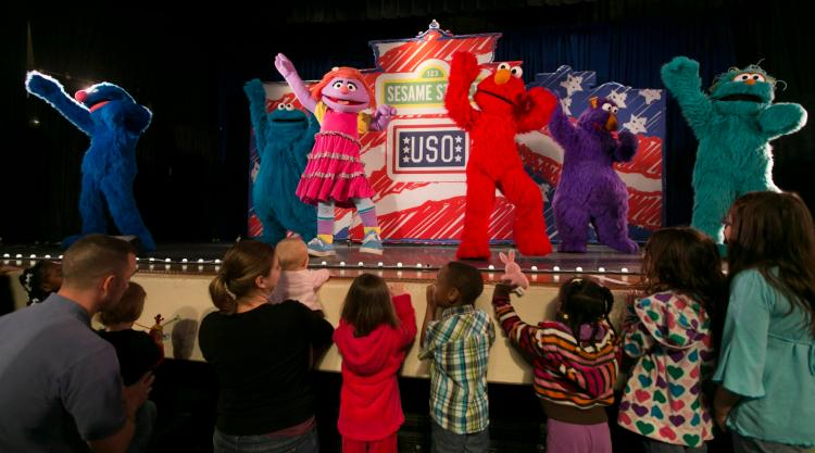 Grover, Cookie Monster, Katie, Elmo, Honker and  Rosita sing and dance for service members and their kids during The Sesame Street/USO Experience for Military Families which kicked off April 7, 2012 at Scott Air Force Base. (USO photo by Fred Greaves)