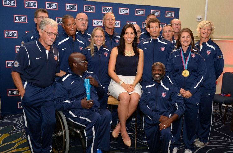 2012 U.S. Olympic swimmer Kate Ziegler poses with athletes at a USO-hosted pep rally Team USA Invictus Games particpants on Friday in Herndon, Virginia. USO photo by Mike Theiler