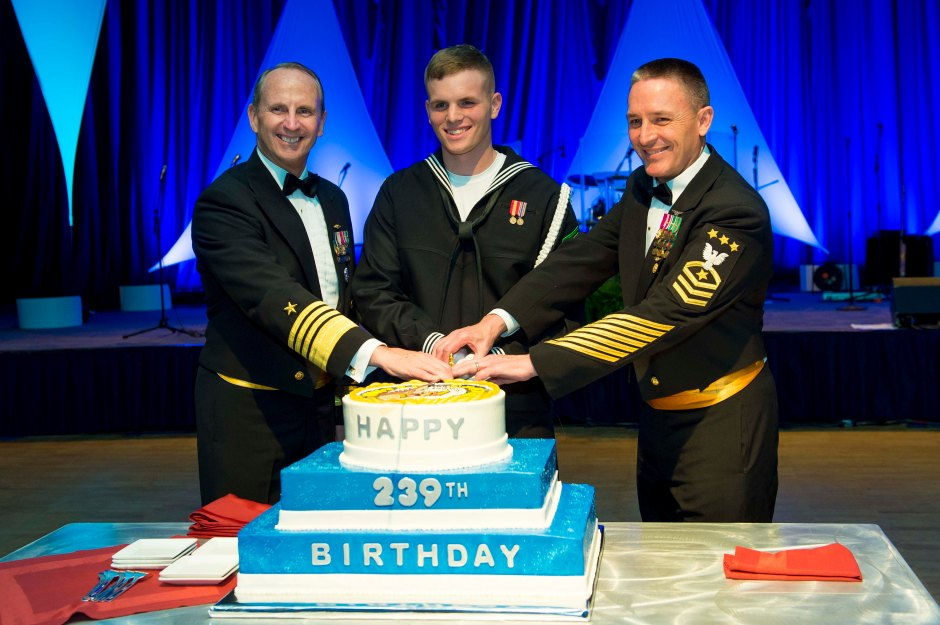 Chief of Naval Operations Adm. Jonathan Greenert and Master Chief Petty Officer of the Navy Mike Stevens cut a birthday cake with the most junior sailor in attendance to celebrate Navy's 239th birthday. Navy photo by  Peter D. Lawlor