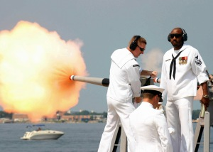 Sailors fire a 40 mm saluting cannon. Navy photo