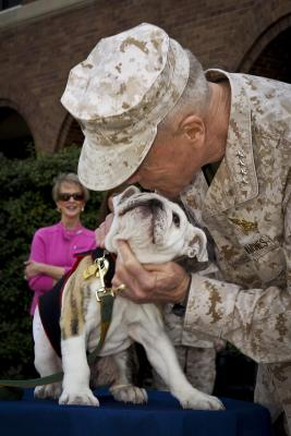 Chesty always gets respect - and hugs. DOD photo