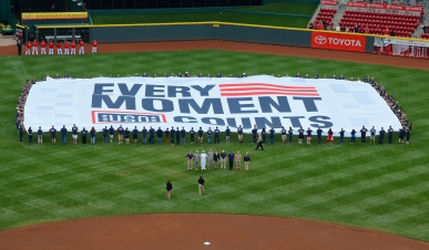 The USO's Every Moment Counts flag is displayed at The Great American Ballpark in Cincinnati on Sept. 11. USO photo by Mike Theiler