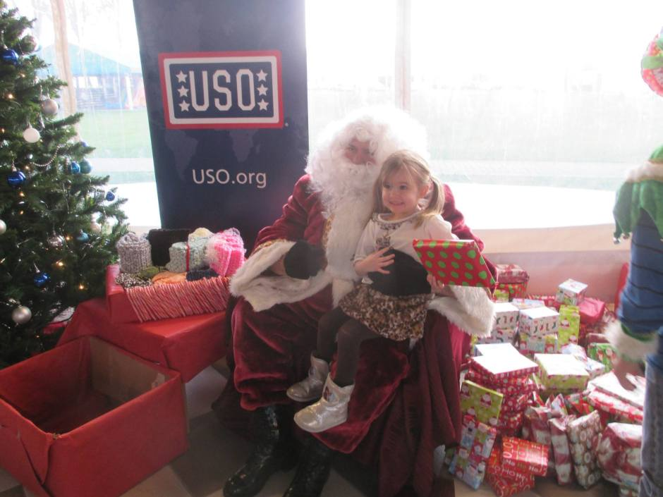 Military children receive gifts from Santa at USO Vicenza, Italy.