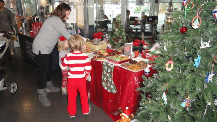 Military families help themselves to holiday treats. USO photo